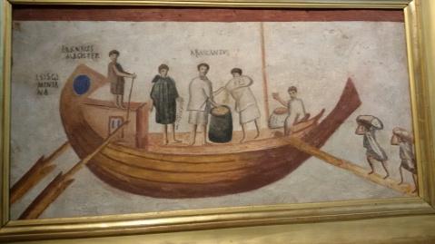 Le operazioni di carico e scarico di una nave romana di derrate alimentari