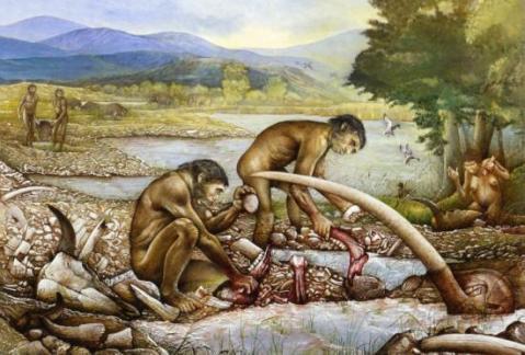 Ricostruzione di un pasto con carcasse di animali dell'uomo preistorico cacciatore-raccoglitore