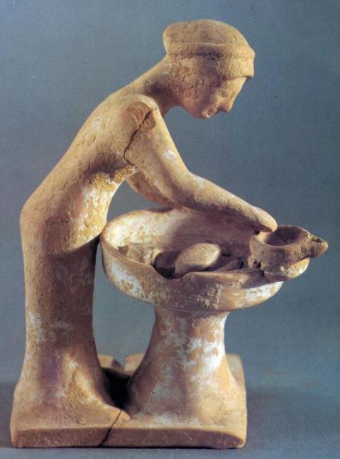 Statuetta di donna che impasta il pane da Tanagra, nella Grecia centrale