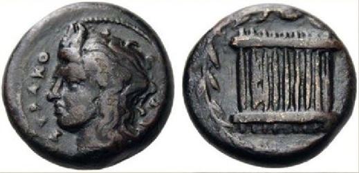 Una rara rappresentazione di una siringa sul rovescio di un hemilitron di bronzo di Siracusa (344-317 a.C.)